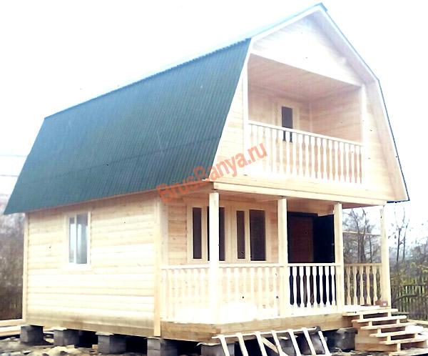 брусовой дом с террасой и балконом в Никольское